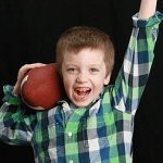 TJ posing with a football
