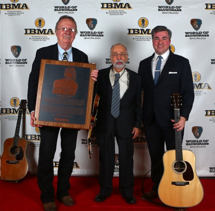 """Roland White (center) at the International Bluegrass Music Association awards show in Raleigh in September, when he accepted the IBMA Hall of Fame award on behalf of his late brother Clarence, the legendary guitar player. (Clarence and Roland, late brother Eric, Billy Ray Latham and LeRoy McNees were the Country Boys in the """"Mayberry on Record"""" episode of TAGS. All but Roland, who had joined the Air Force, also were in the epilogue of """"Quiet Sam."""" All but Eric went on to form the Kentucky Colonels. Clarence later joined The Byrds. Holding the Hall of Fame plaque is Herb Perdesen, a longtime member of The Dillards. At right is top bluegrass performer Patrick Sauber. Photo by Dave Brainard."""
