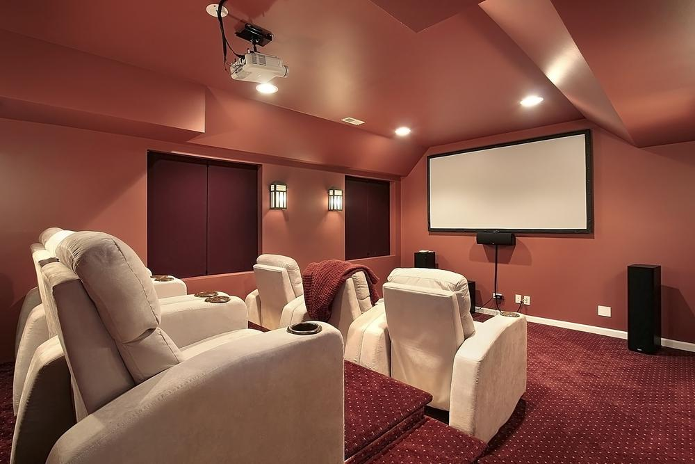 Luxurious theater in upscale home with red walls
