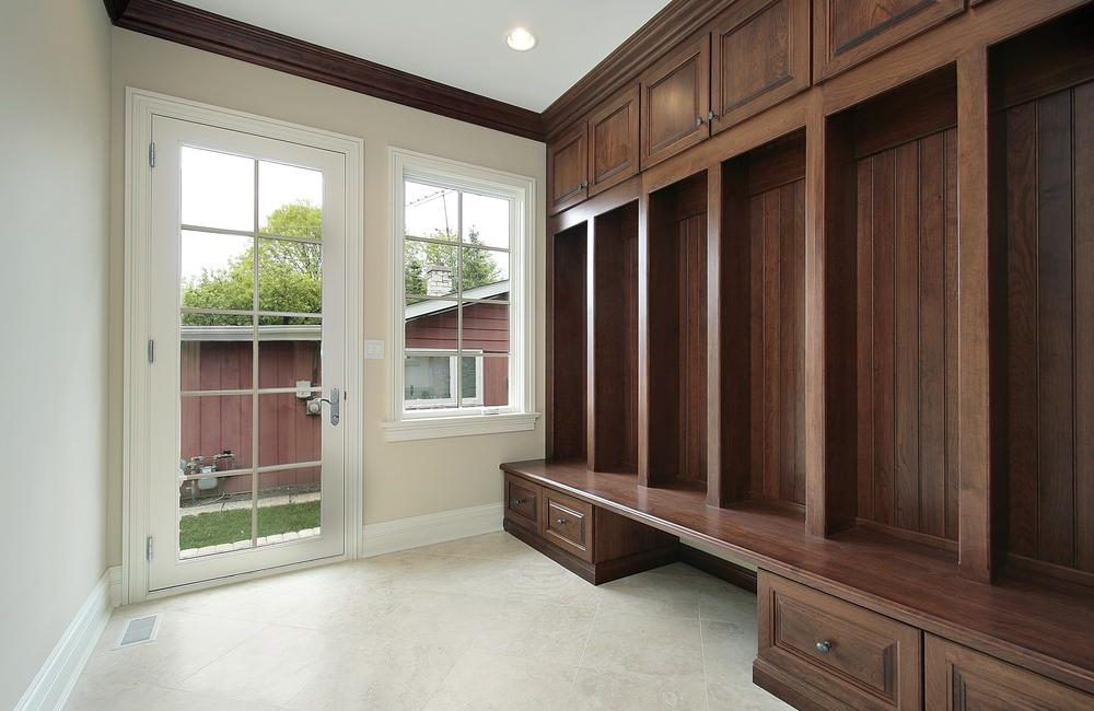 Mudroom in new construction home with wood cabinetry
