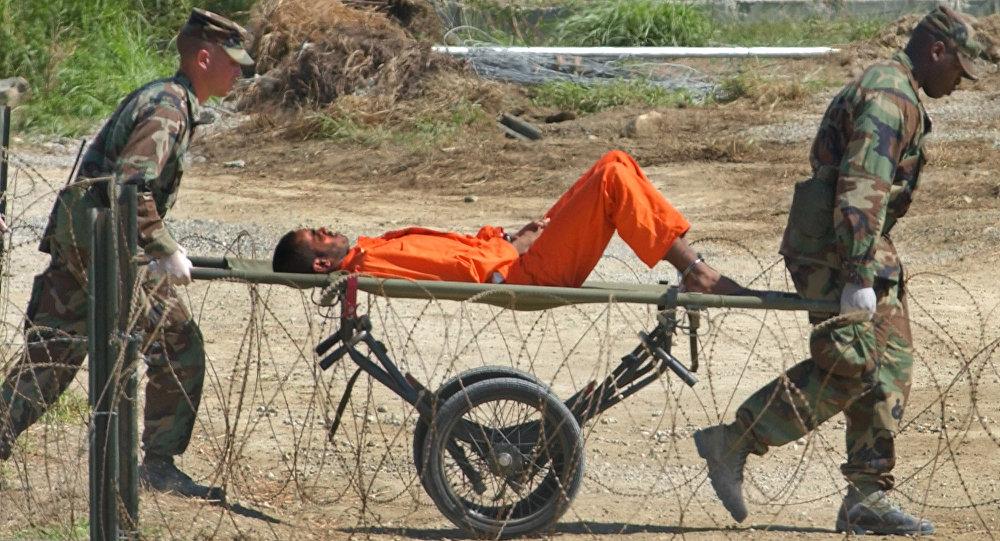 В отчете говорится, что еще троих заключенных Гуантанамо разрешили освободить