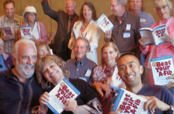 Group holding copies of Beat Your A-Fib books at A-Fib.com
