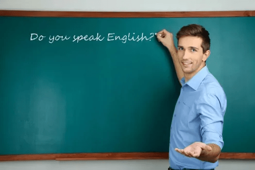 English teacher in front of a blackboard