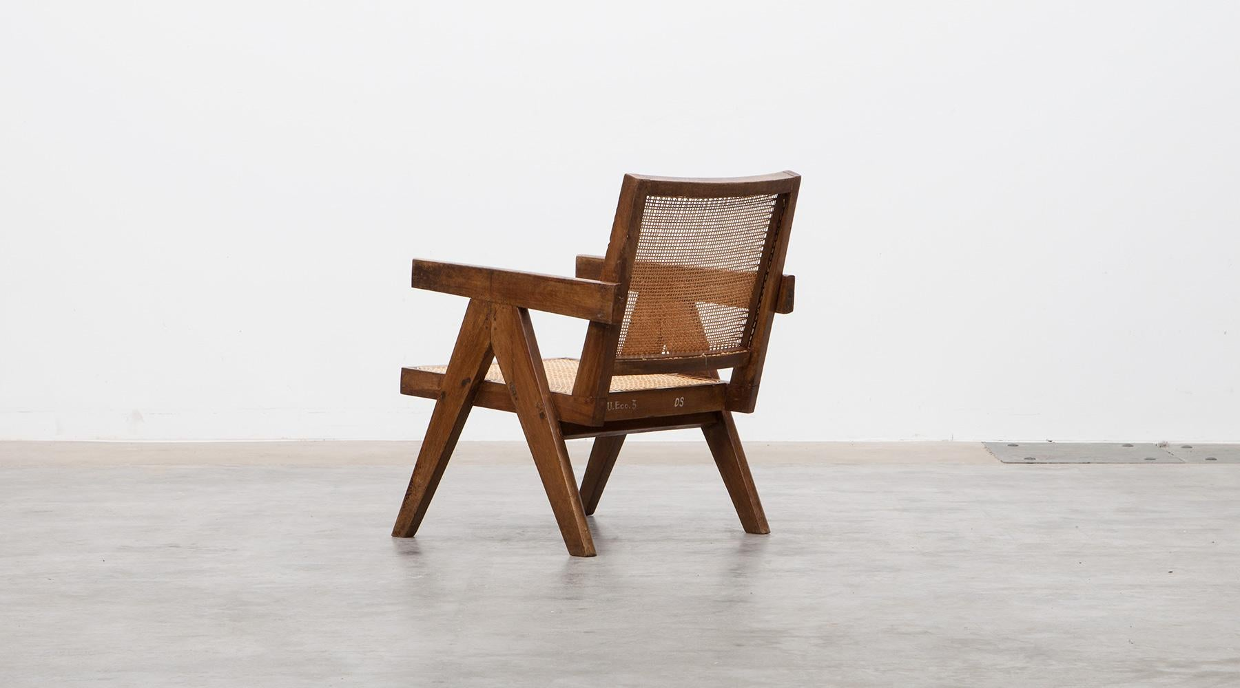 floor rocking chair india ophthalmic exam chairs 1950s brown wooden teak and cane lounge by pierre jeanneret c at 1stdibs