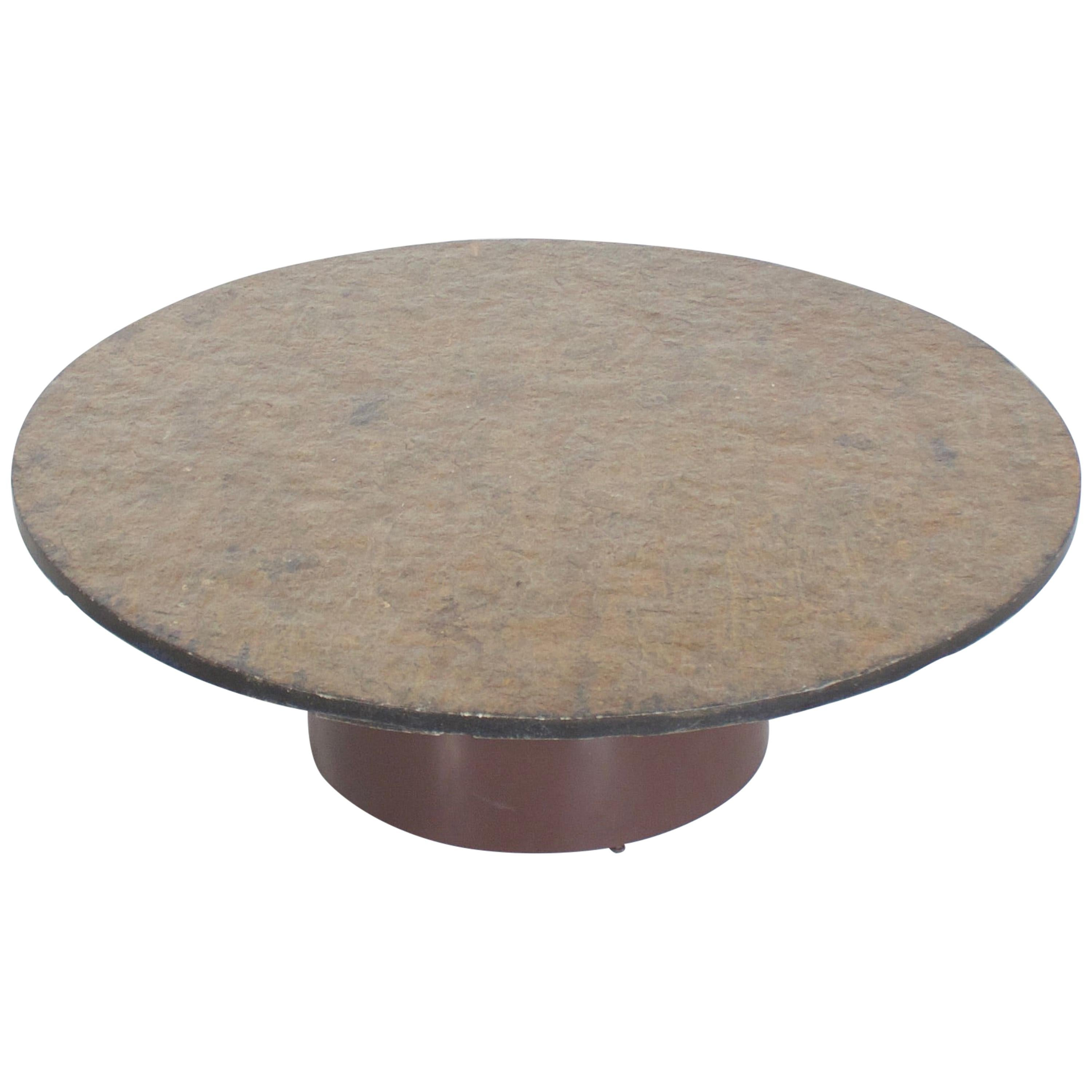 brutalist 1970s round coffee table with a brown green slate top