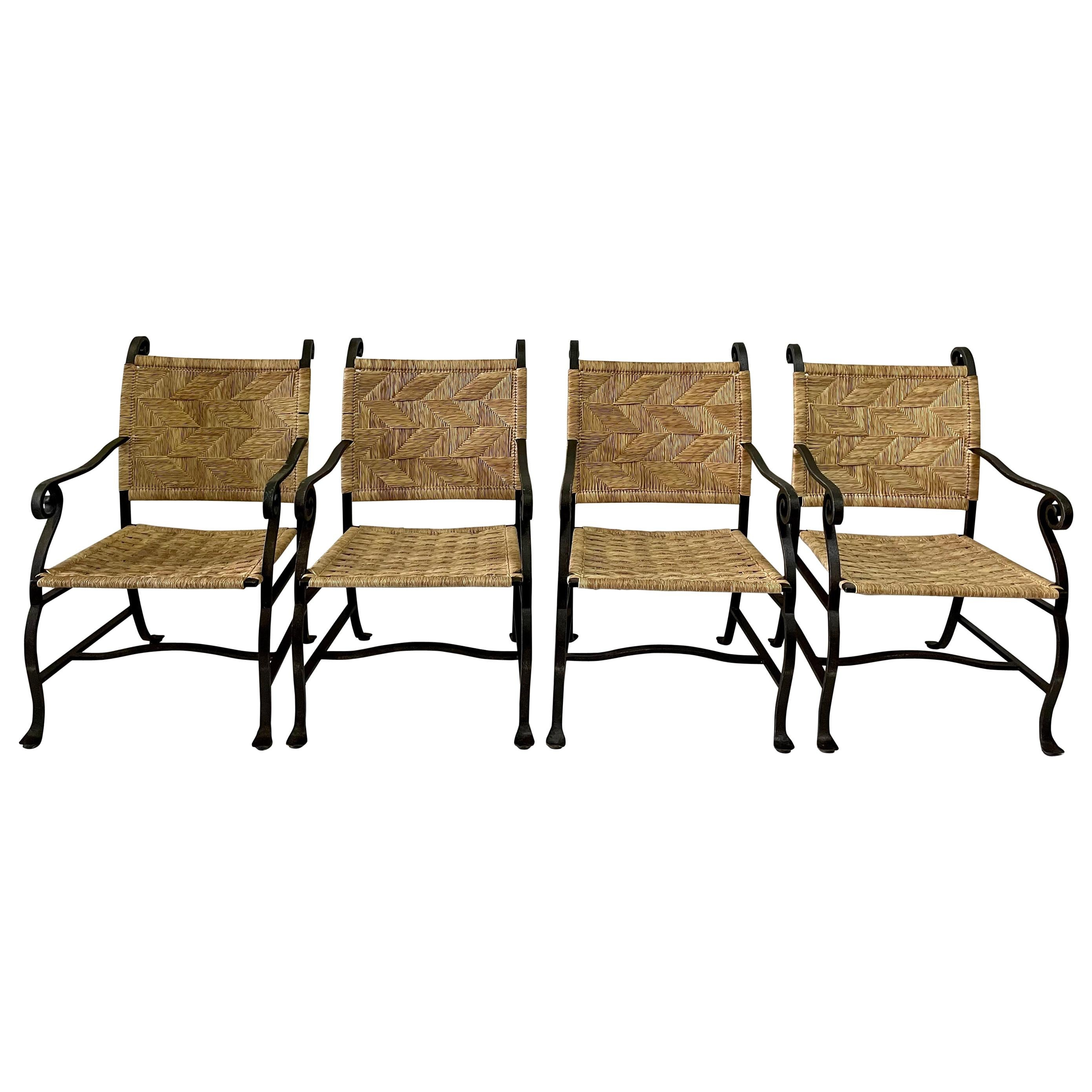 4 hand wrought iron and woven raffia armchairs