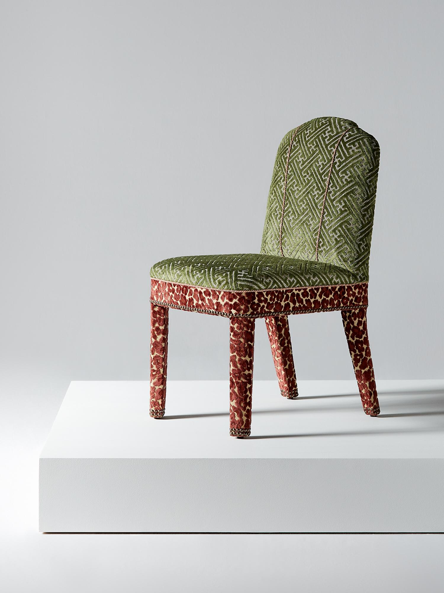 Studded Dining Chairs Abbas Dining Chair In Leopard Garnet