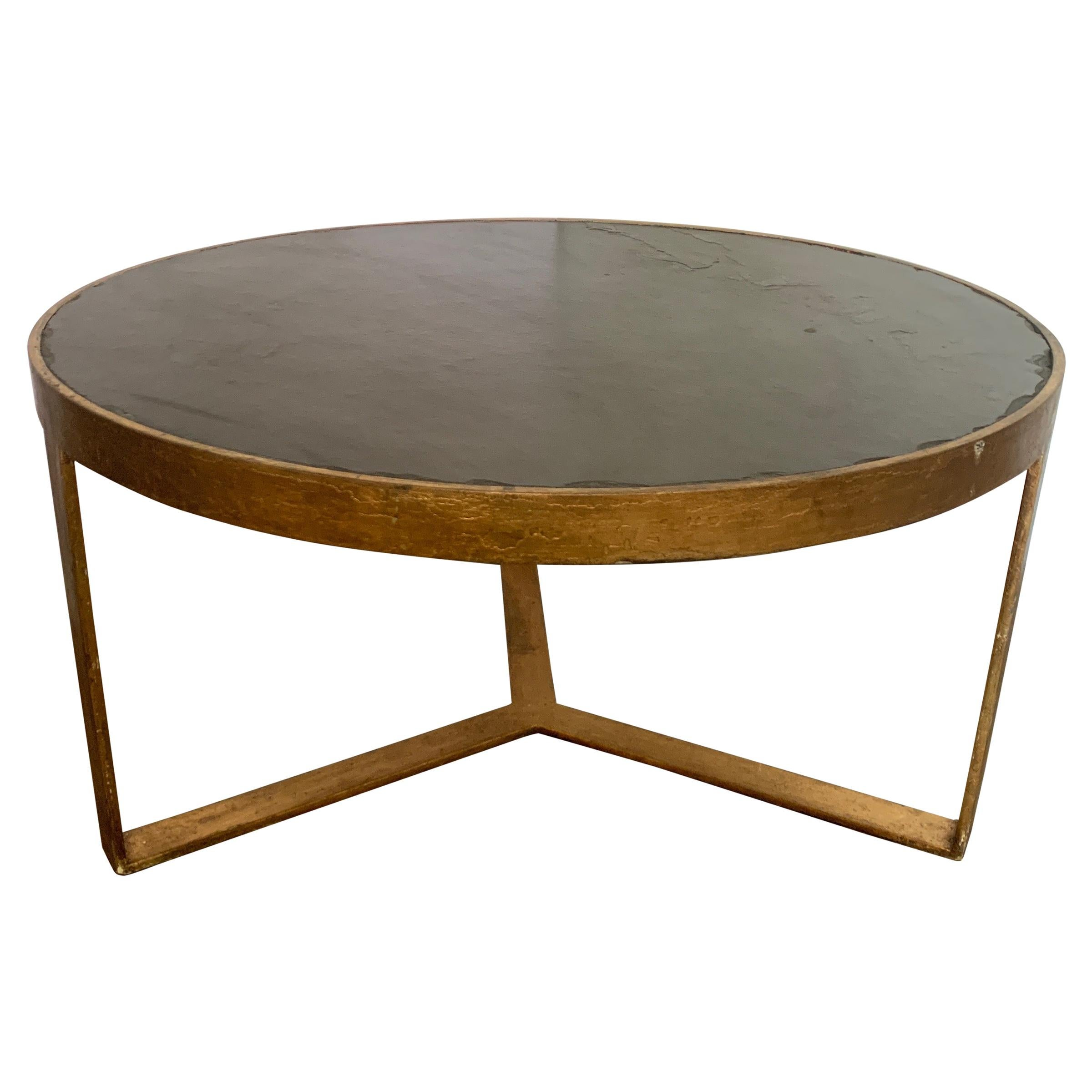 antica collection fabricated round iron table with gold finish black slate top
