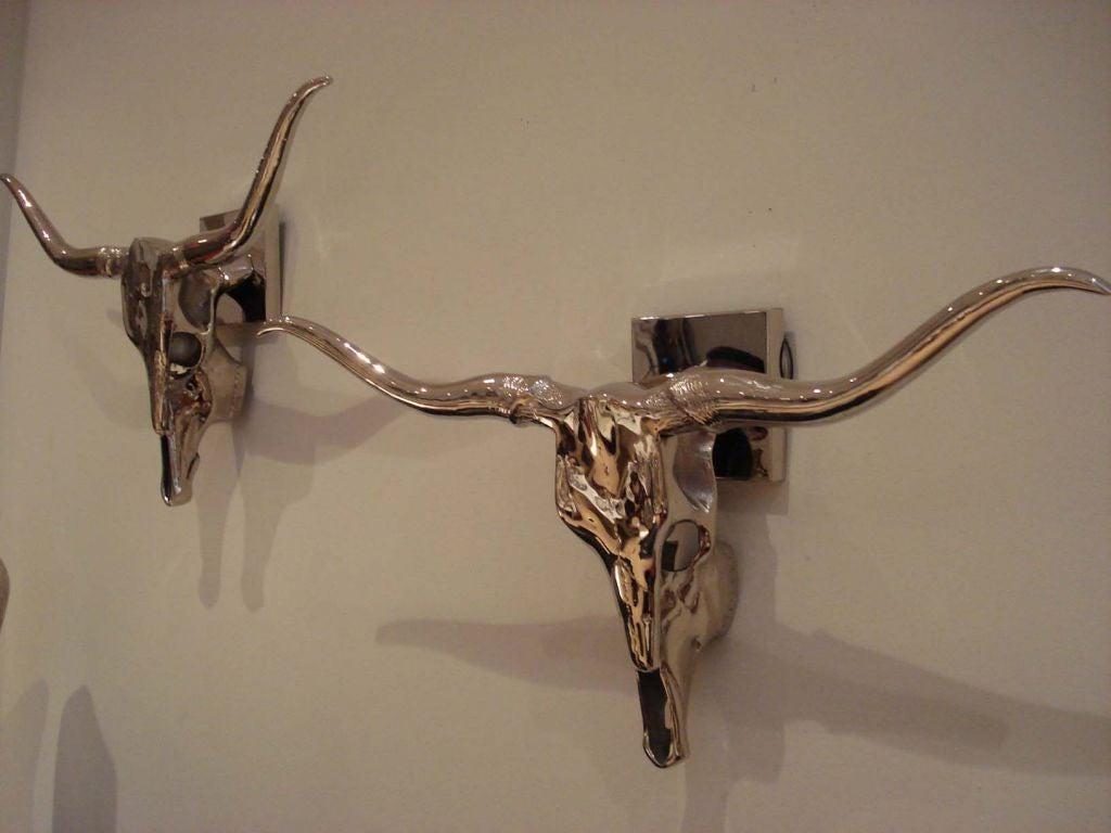 Pair of Skull Sconces. at 1stdibs
