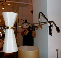 Swingarm sconce by Lunel at 1stdibs