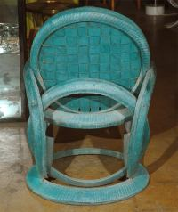 Pair of indoor/outdoor rubber tire radial green chairs at