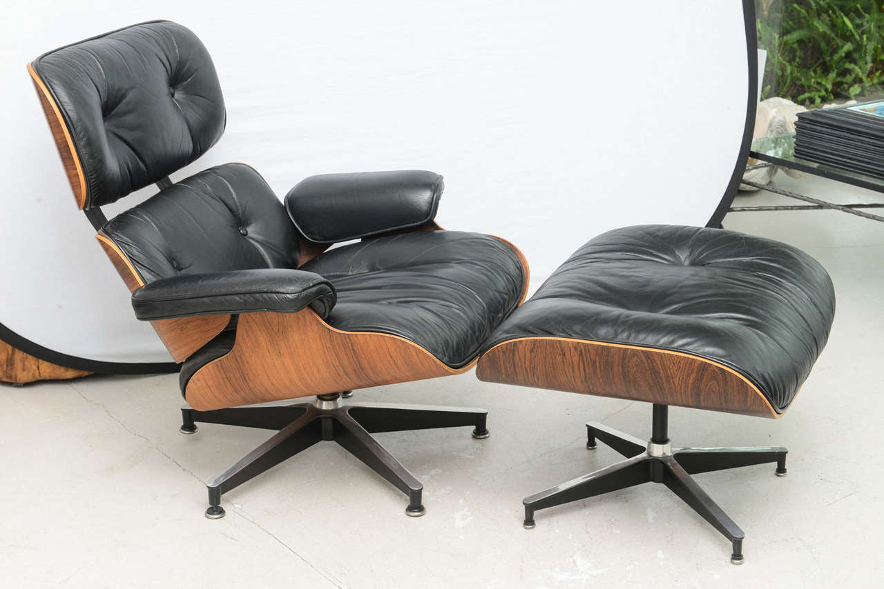 eames style lounge chair and ottoman rosewood black leather aerodynamic office chairs two vintage