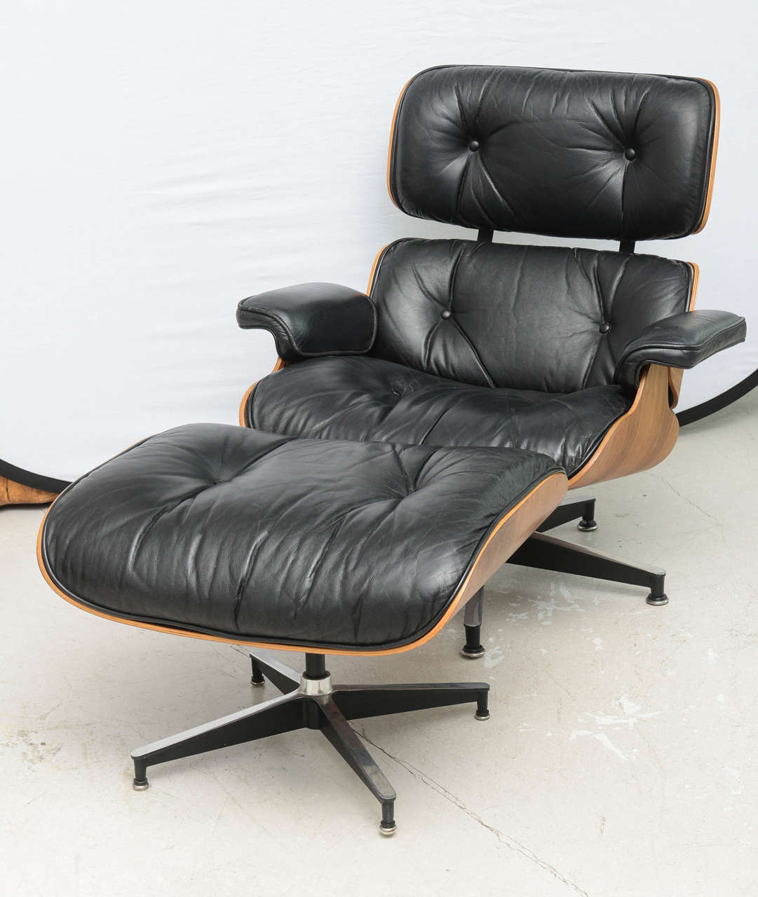eames style lounge chair and ottoman rosewood black leather types of covers for wedding two vintage chairs
