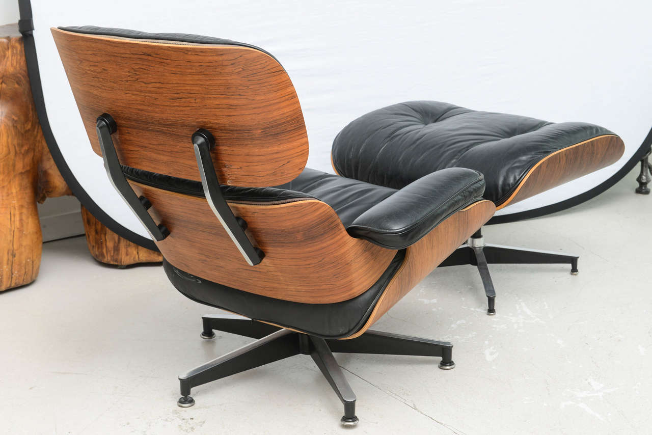 eames style lounge chair and ottoman rosewood black leather pottery barn wooden dining chairs two vintage