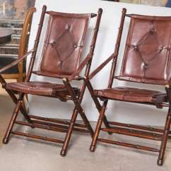Bamboo Folding Chair Fontaine Wingback Set Eighteen Leather Style Chairs In Fine Button Of Form Each A Tufted Brown Slightly