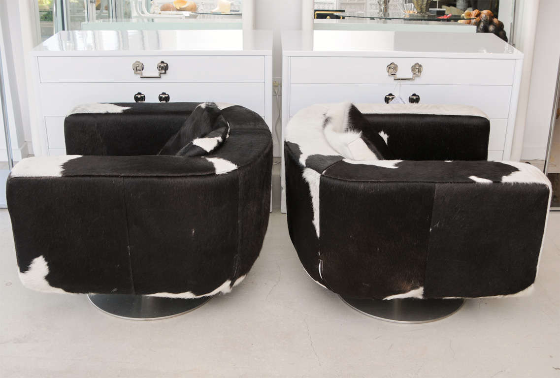black and white cowhide chair swivel recliner pair of chairs at 1stdibs