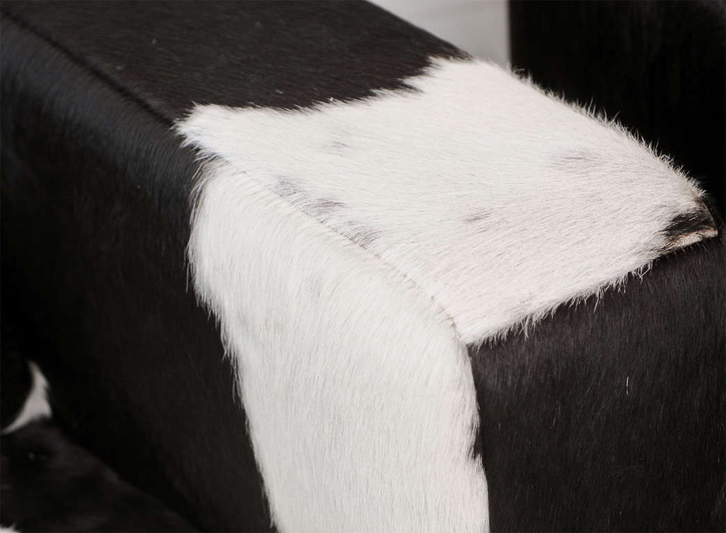black and white cowhide chair infinity it 8500 massage pair of swivel chairs at 1stdibs