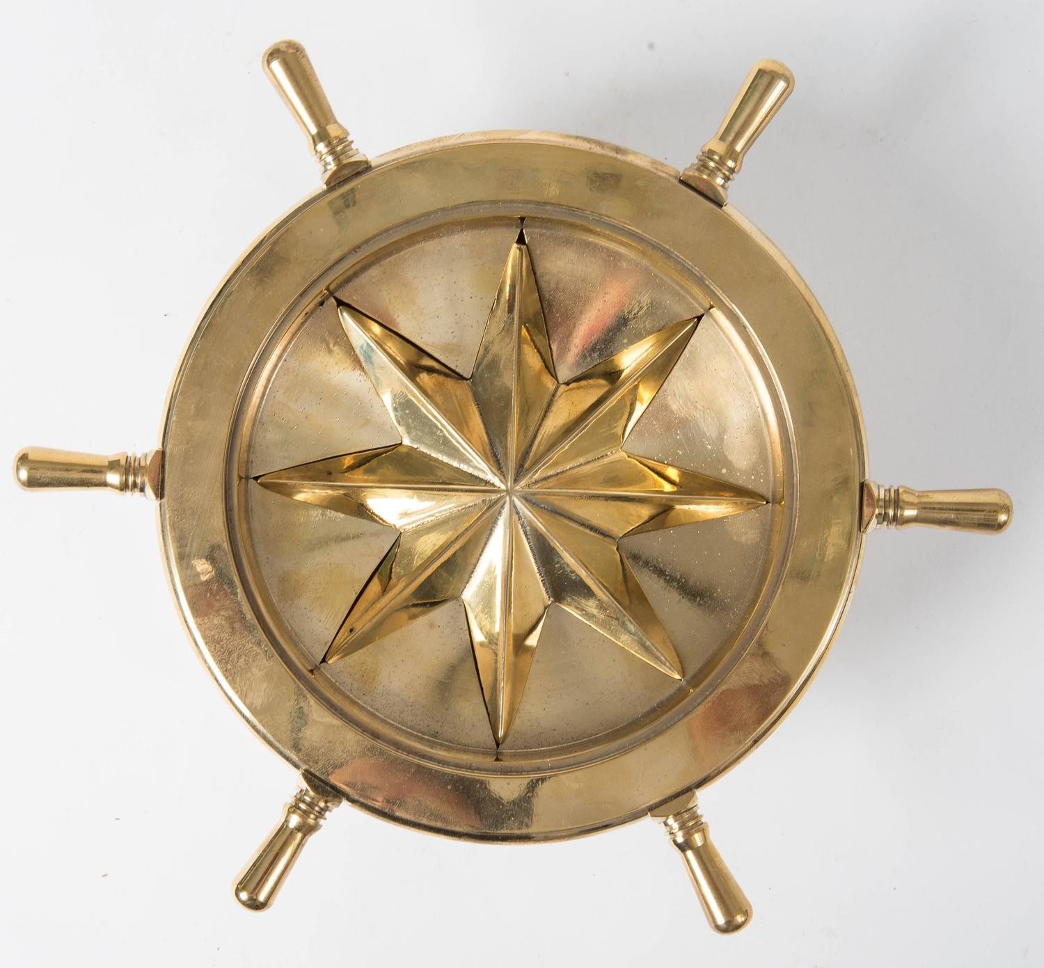 revolving chair without wheels boxed cushions small brass nautical themed ash tray with rotating ships