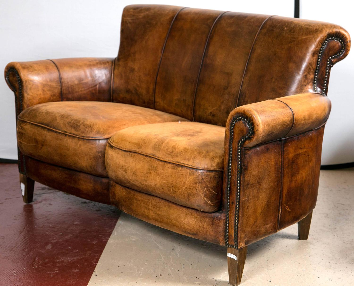 leather couch and chair parisian bistro chairs vintage french distressed art deco sofa at 1stdibs
