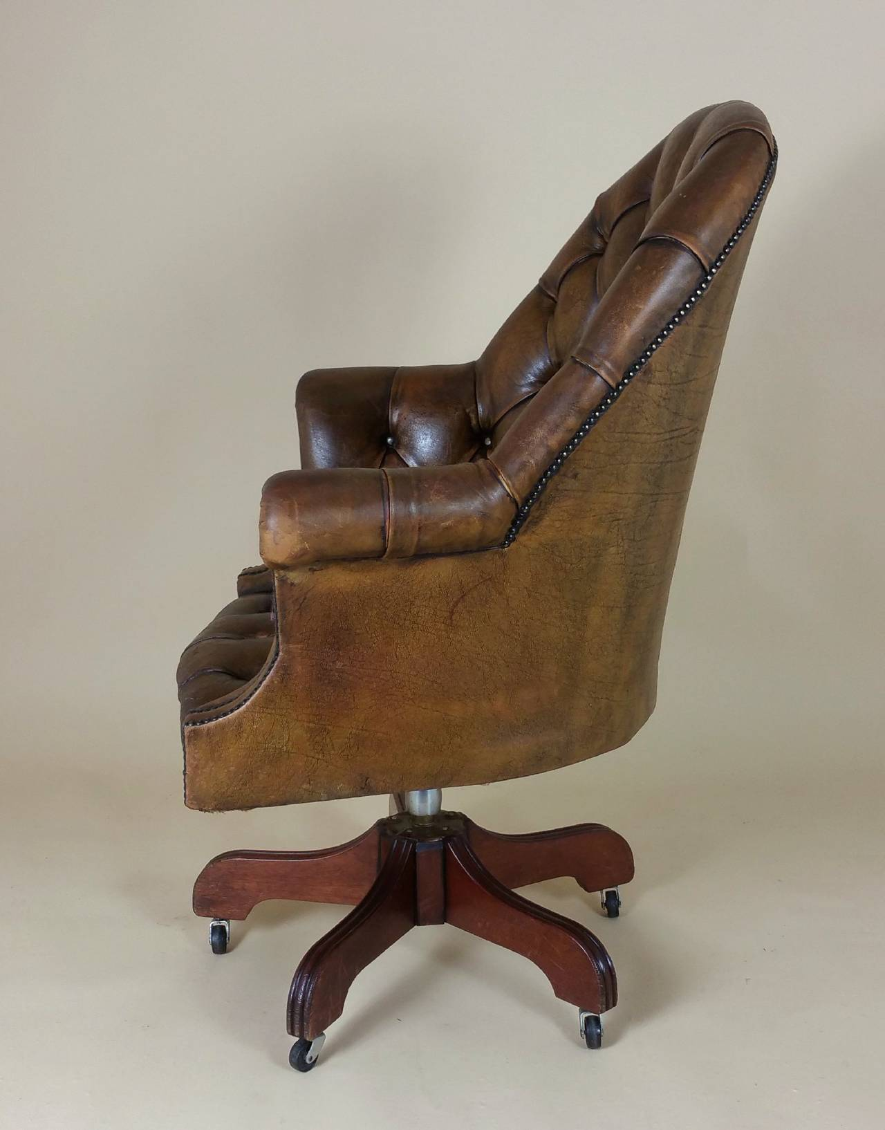 revolving chair colour folding lawn chairs with attached side table mid 20th c buttoned leather armchair at 1stdibs