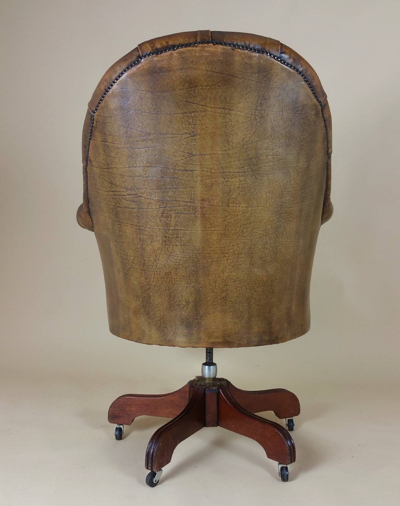revolving chair colour cool camping chairs mid 20th c buttoned leather armchair at 1stdibs