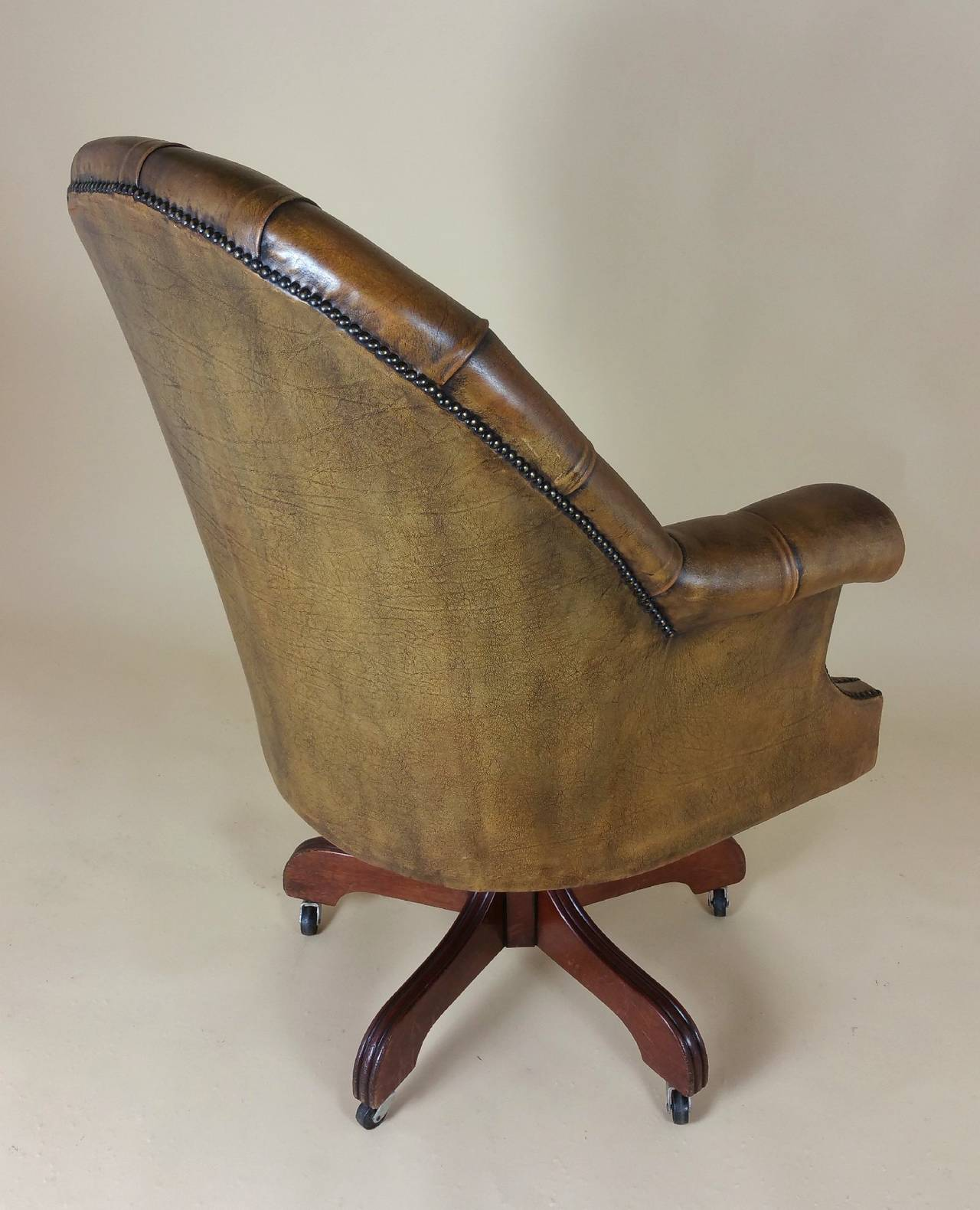 revolving chair colour tea table and chairs mid 20th c buttoned leather armchair at 1stdibs