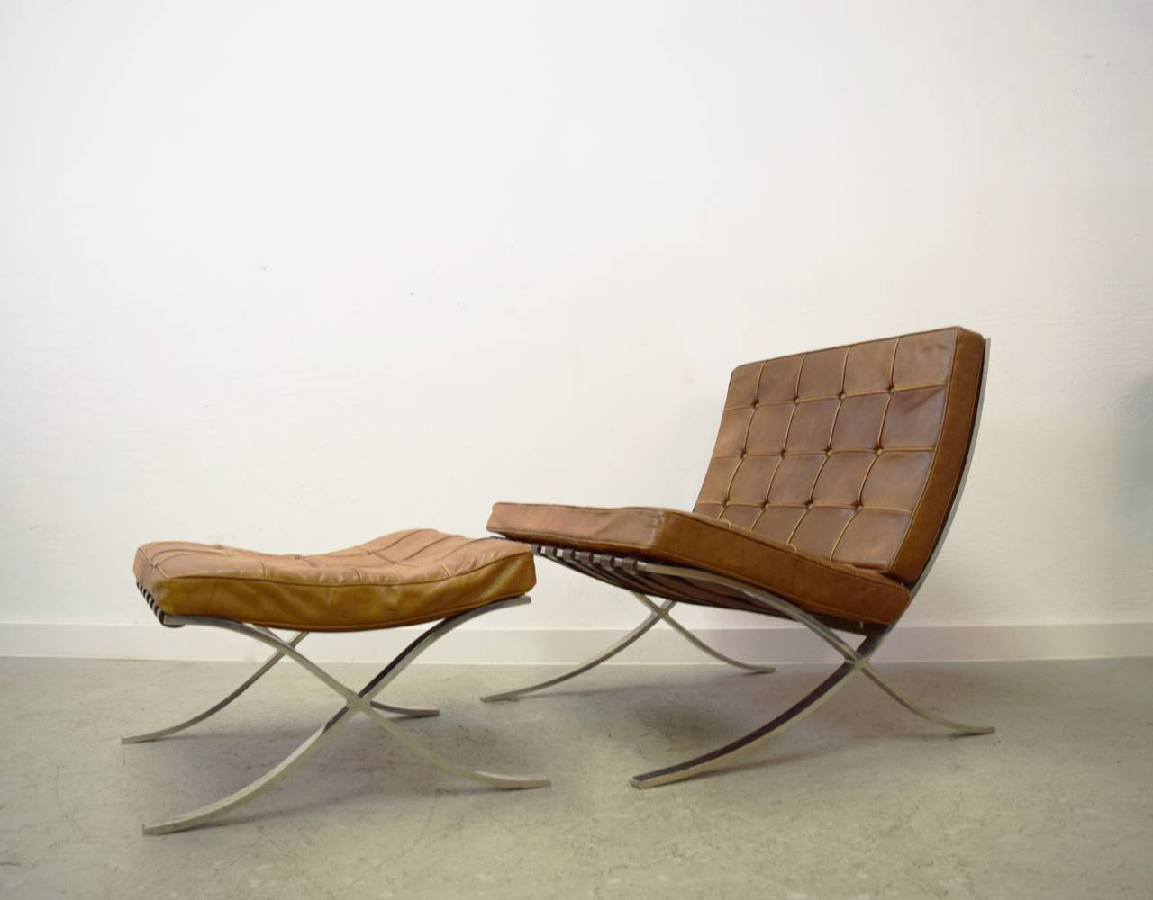 mies van der rohe barcelona chair steel price in delhi ludwig and ottoman at