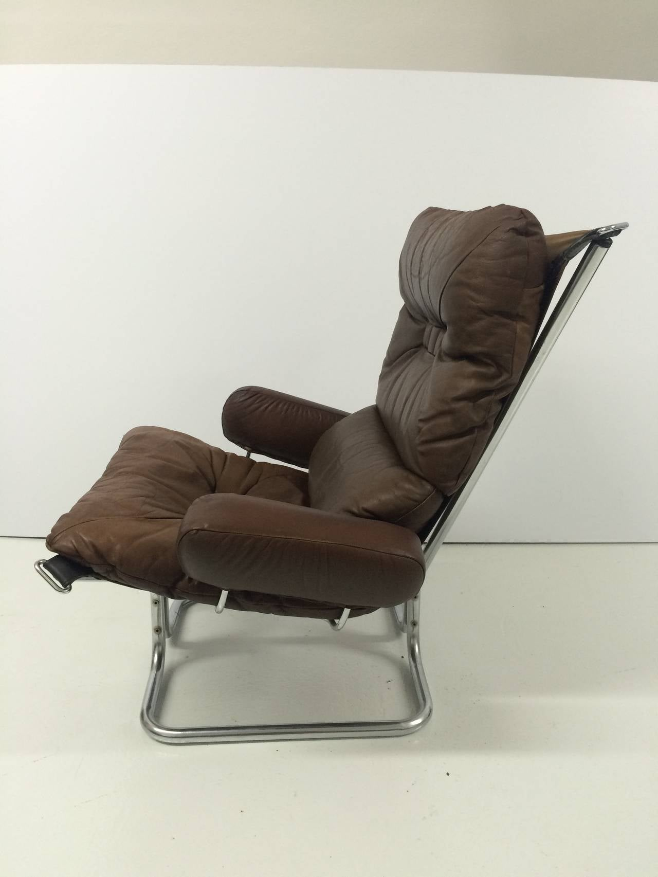 leather lounge chair with ottoman hanging from tree ingmar relling chrome and