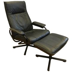Recliner Vs Chair With Ottoman Round Glass And Wood Dining Table Chairs Danish Mid Century Modern Black Pebbled Leather Lounge