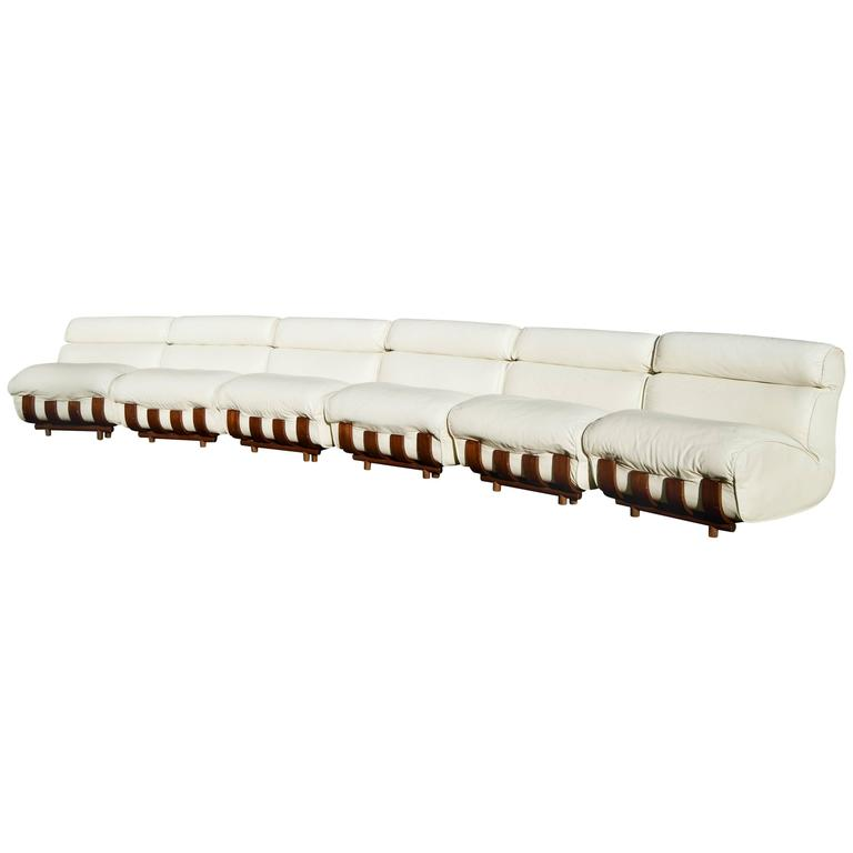 white leather sectional sofa with ottoman patio outdoor furniture wicker set luciano frigerio and ottomans for sale