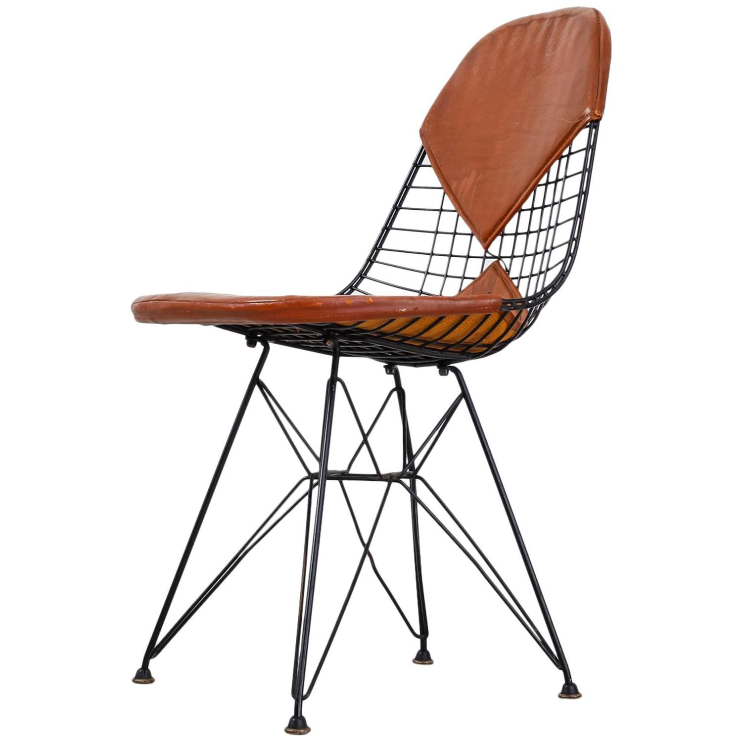 wire dining room chairs small leather for living eames early dkr chair with bikini seat on