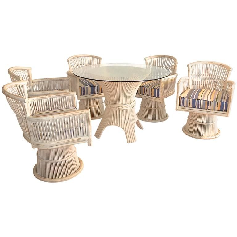 table with swivel chairs rattan nest chair mcguire bamboo sheaf dining and five for sale at