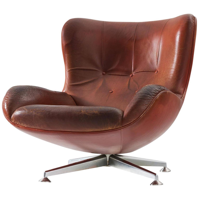 swivel chair brown heavy duty fishing uk illum wikkelsø lounge in leather for