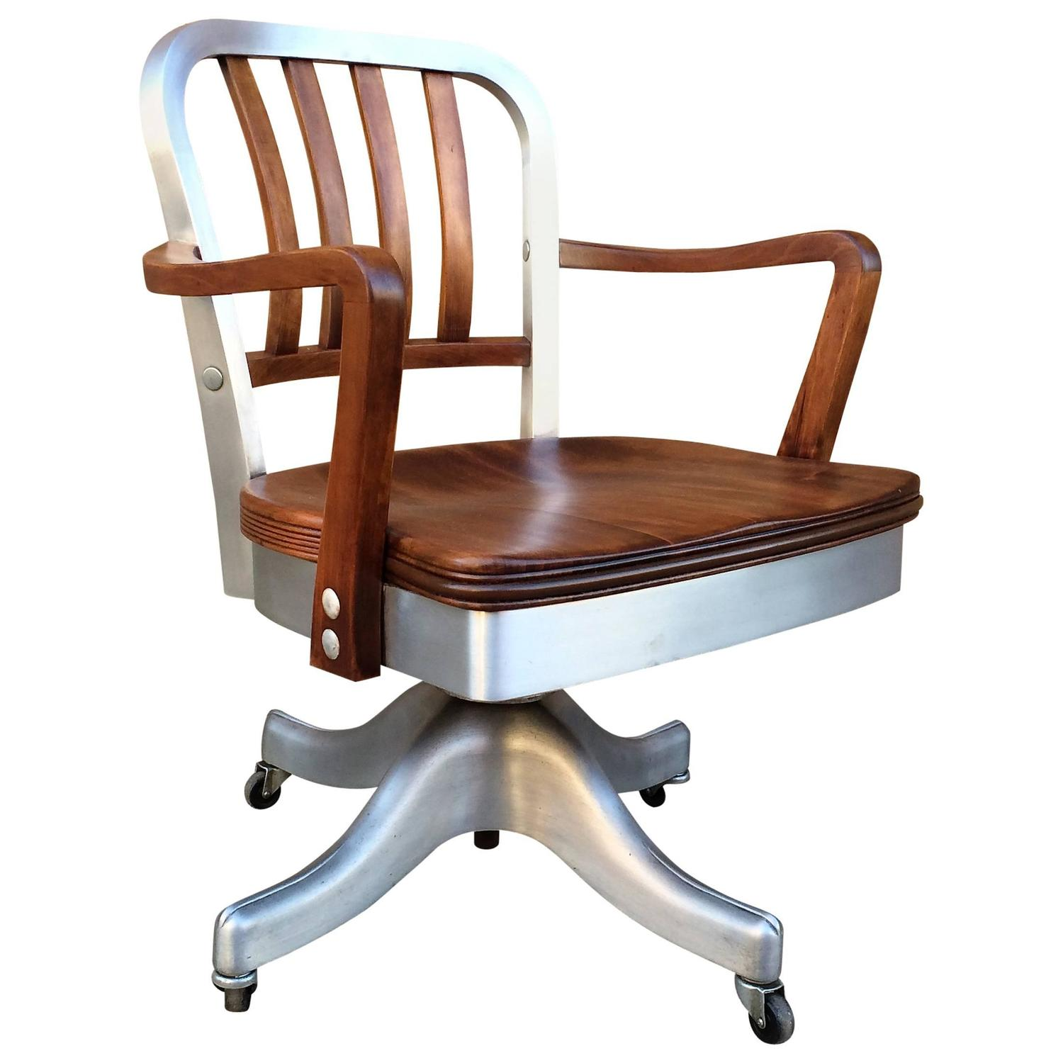 rolling chairs for office wood floors chair wheels shaw walker aluminum and walnut desk
