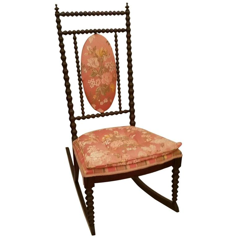 vintage wicker rocking chair cowhide dining room covers 19th century colonial spindle or spool at 1stdibs
