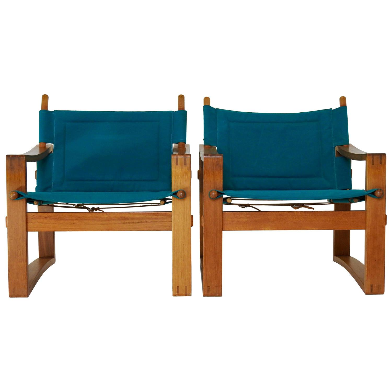 teal lounge chair oak spindle back dining chairs pair of mid century with leather straps