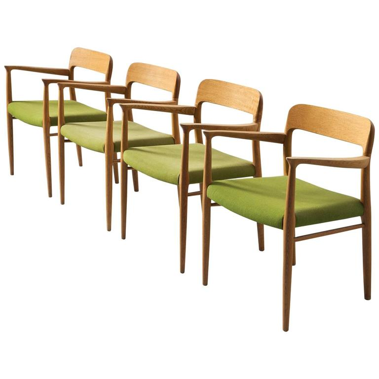 dining chair upholstery dark wood room chairs niels o moller set of four in oak and green fabric for