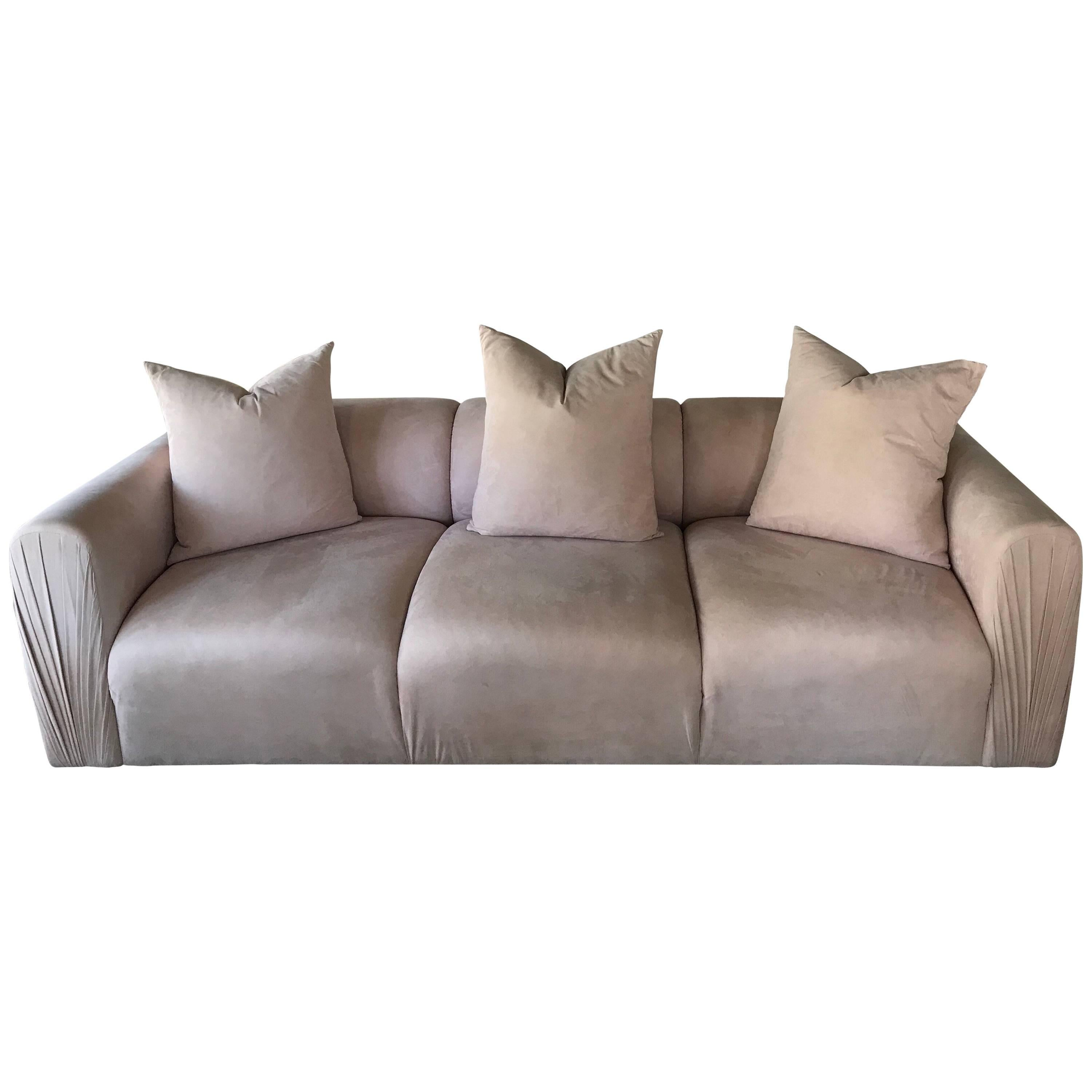 blush ultra suede 80s modern ruched arm sofa with matching pillows