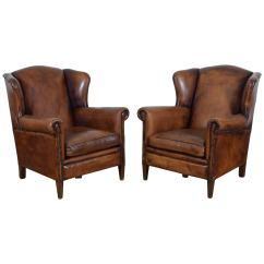 Leather Wing Chairs Time Out Chair Hourglass Pair Of English Cognac Colored From The Mid 20th Century For Sale