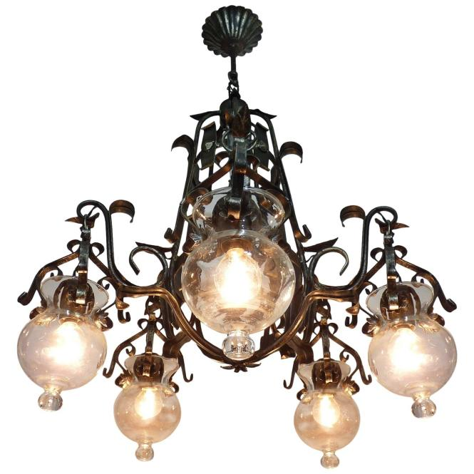 Forged Iron And Tole Cage Form Chandelier With Five Hanging Light Glass Globes For