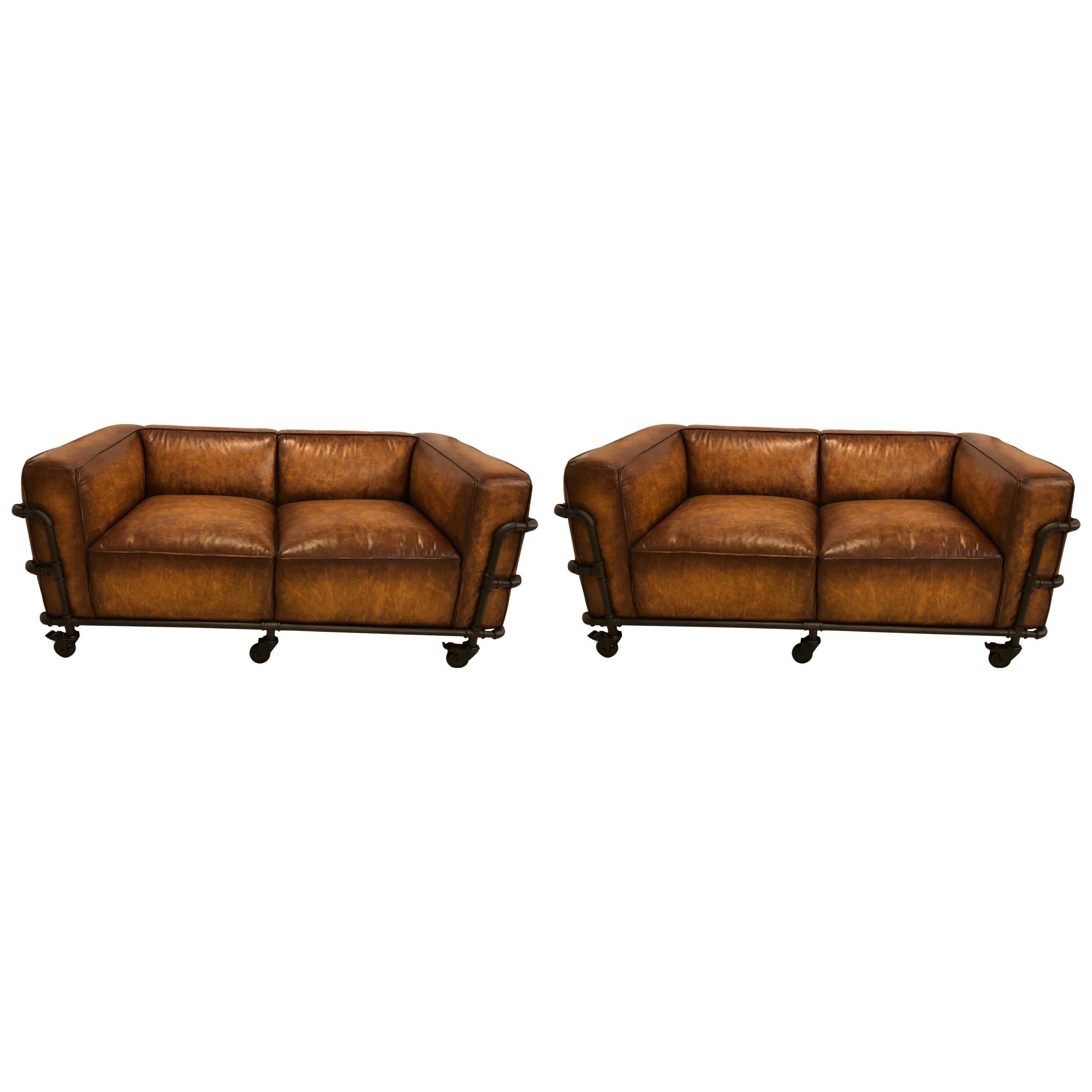 leather armchair metal frame chair design workshop pair of industrial style sofas on piping with casters at 1stdibs
