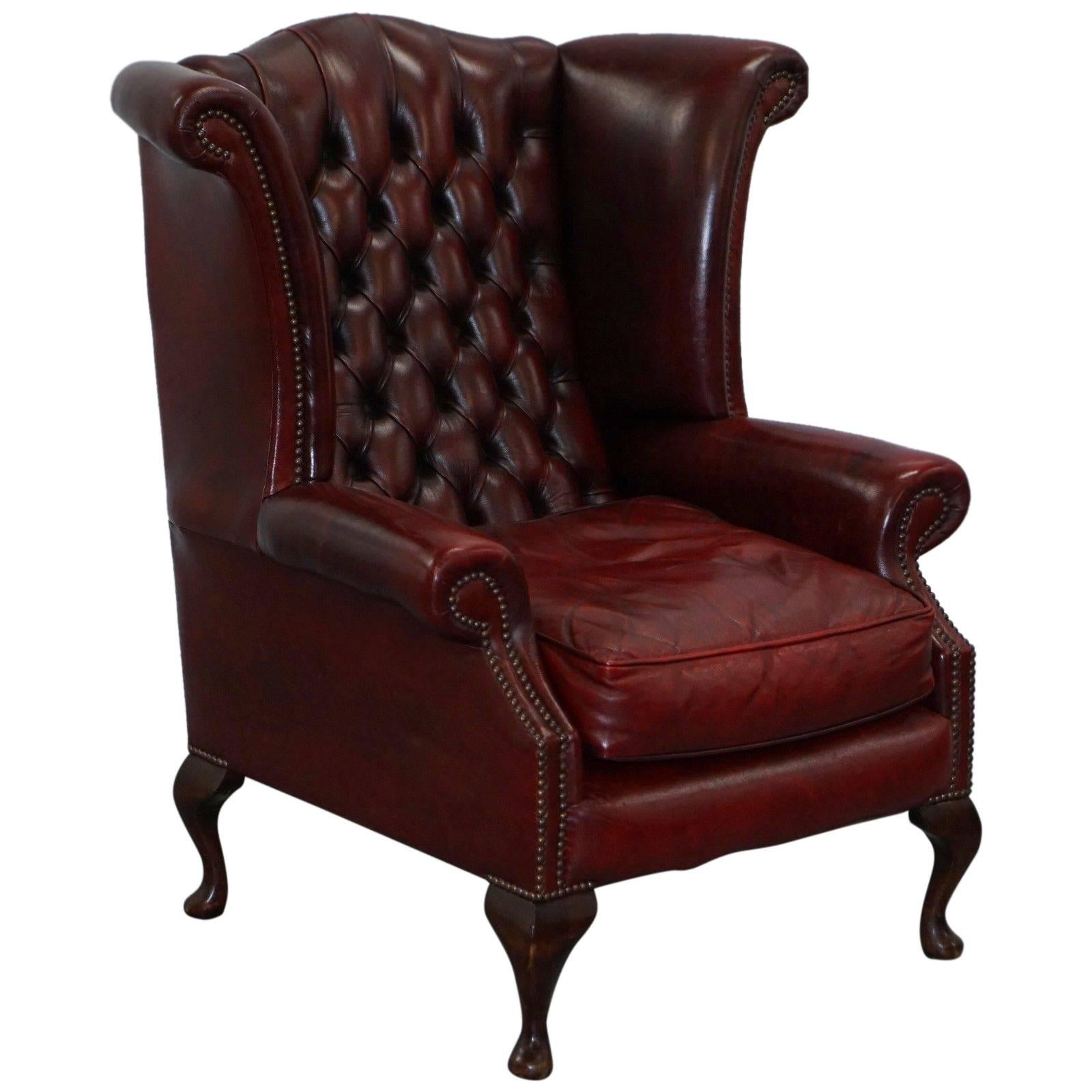 oxblood leather wing chair colorful lawn chairs large comfortable chesterfield queen anne wingback armchair for sale