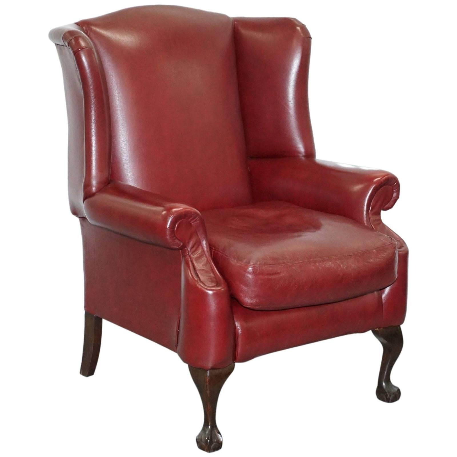oxblood leather wing chair portable beach hammock claw and ball feet large comfortable queen anne wingback armchair for sale
