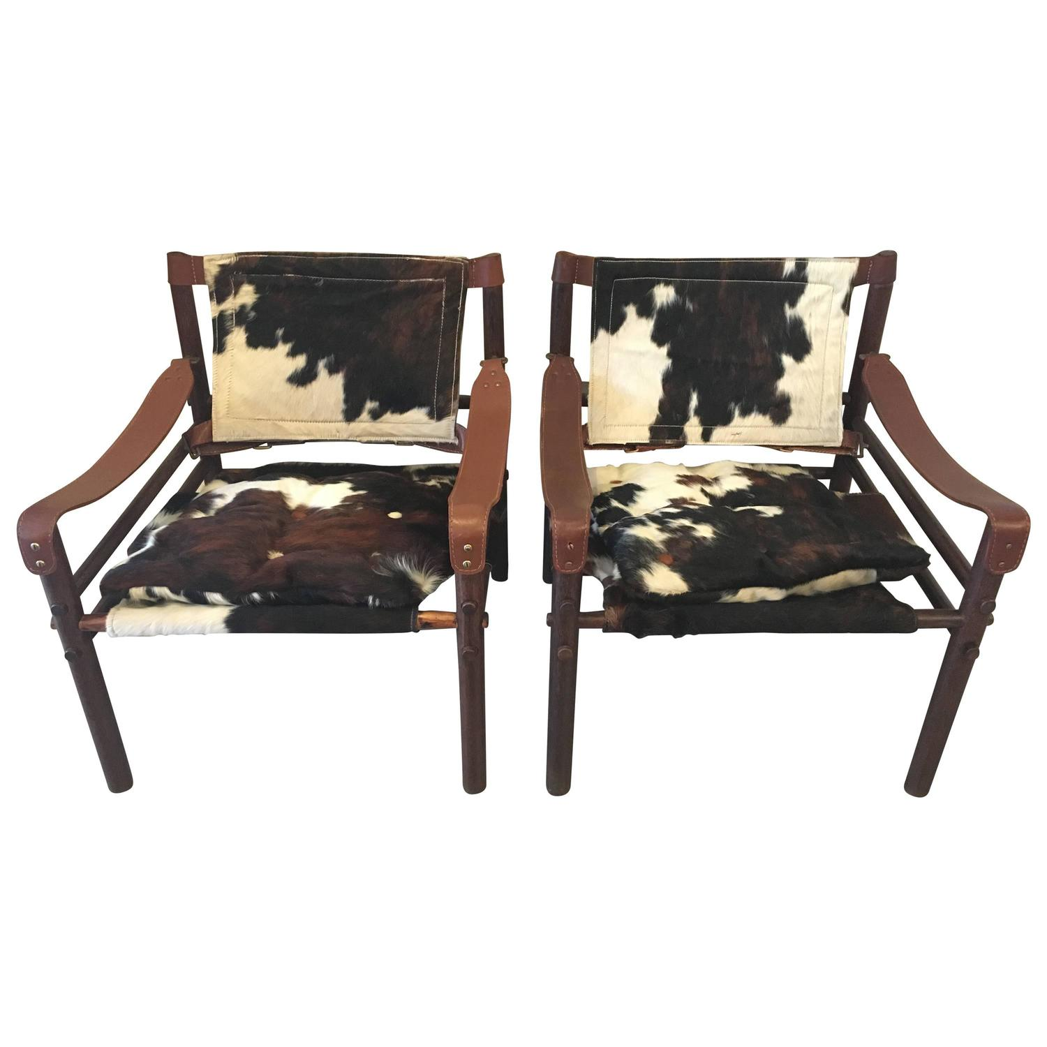 cowhide chairs modern slipcovers for chair and a half pair of arne norell quotsirocco quot safari in at