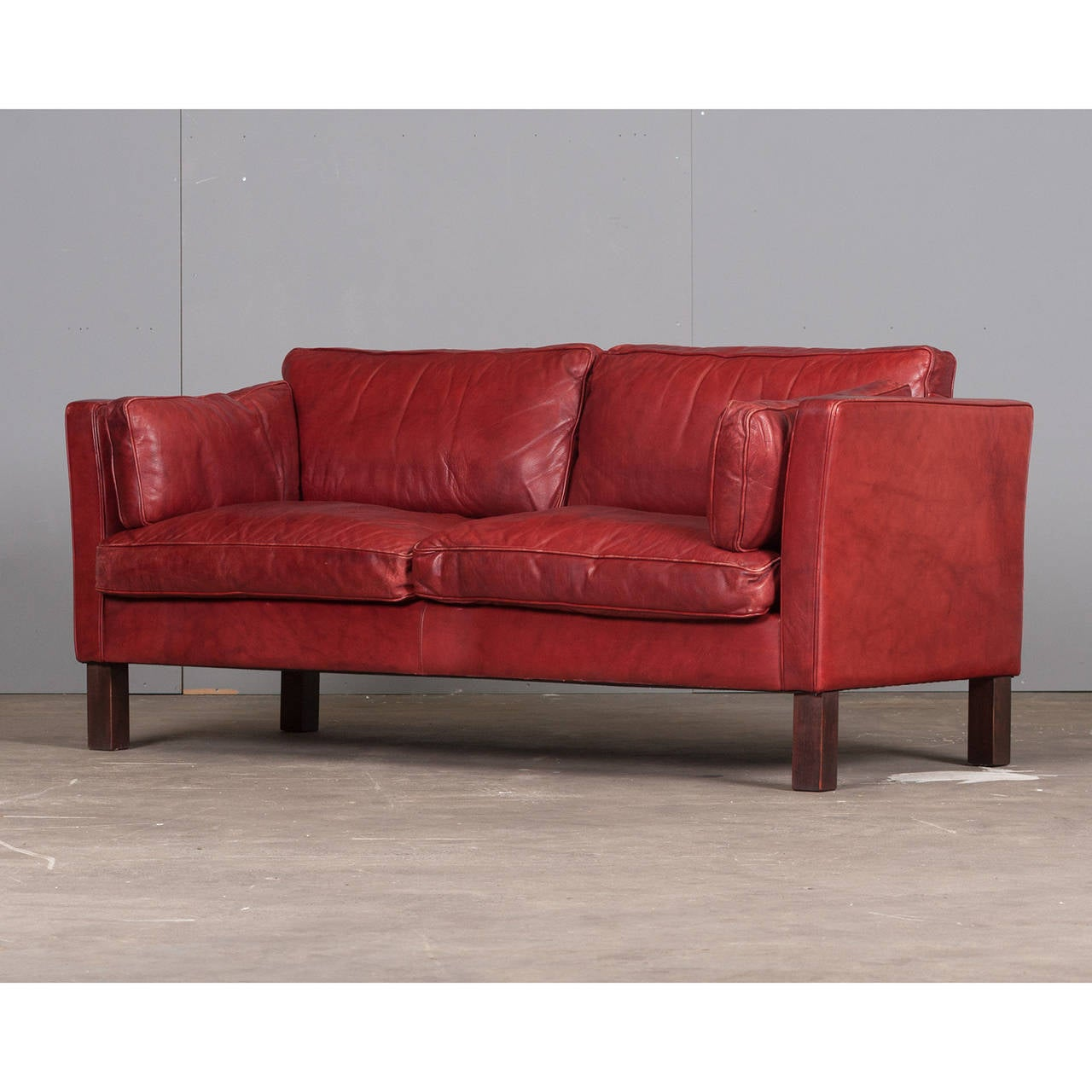 cherry red leather sofa friheten corner bed with storage skiftebo beige danish two seater in by arne
