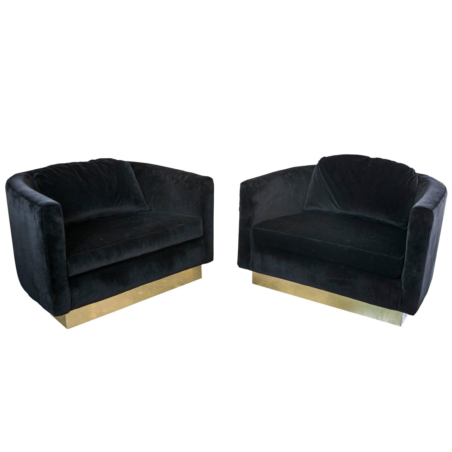 black oversized chair electric recliner motors parts velvet swivel chairs with brass plinths at