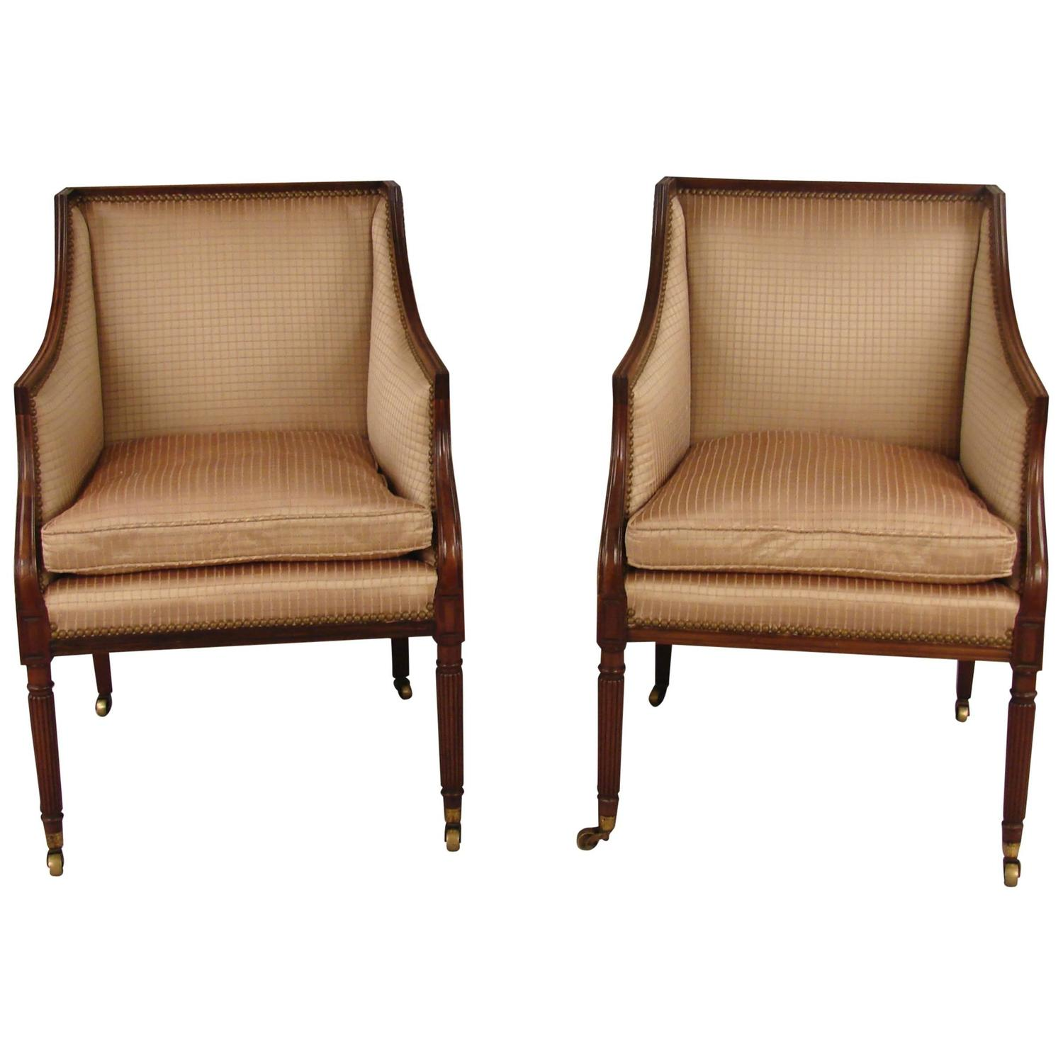 Upholstered Arm Chairs Pair Of Regency Style Upholstered Arm Chairs At 1stdibs