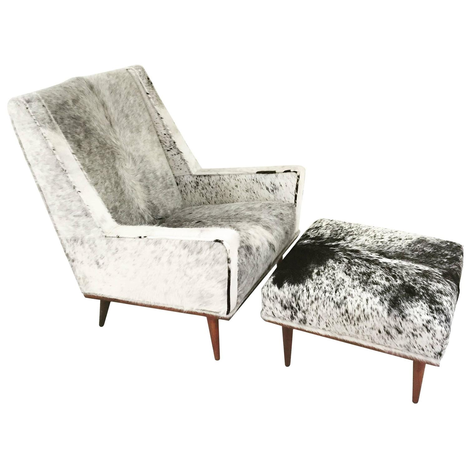 cowhide chairs modern folding camping table and milo baughman style chair ottoman in brazilian
