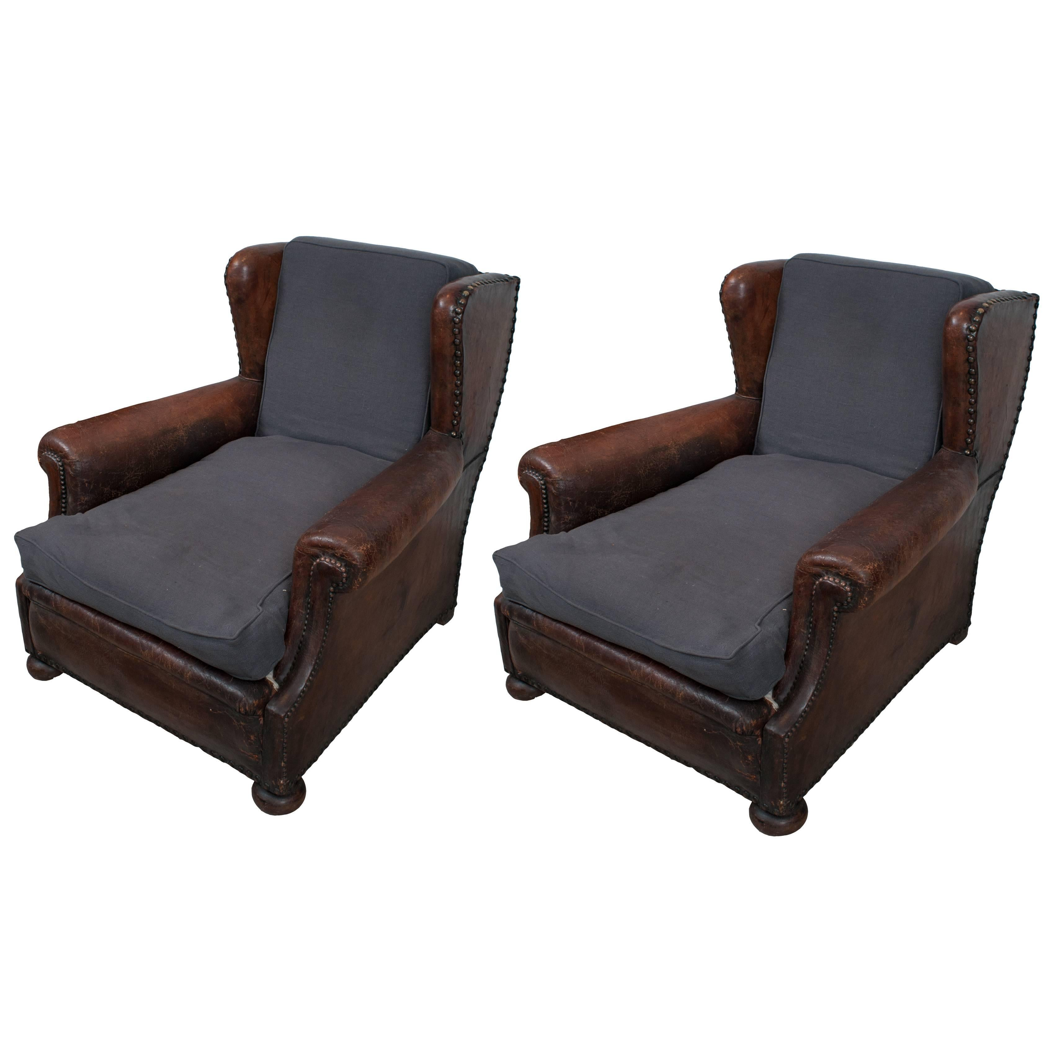 dark brown leather chair bathing for elderly pair of parisian club chairs with piping at and blue linen seat back cushions