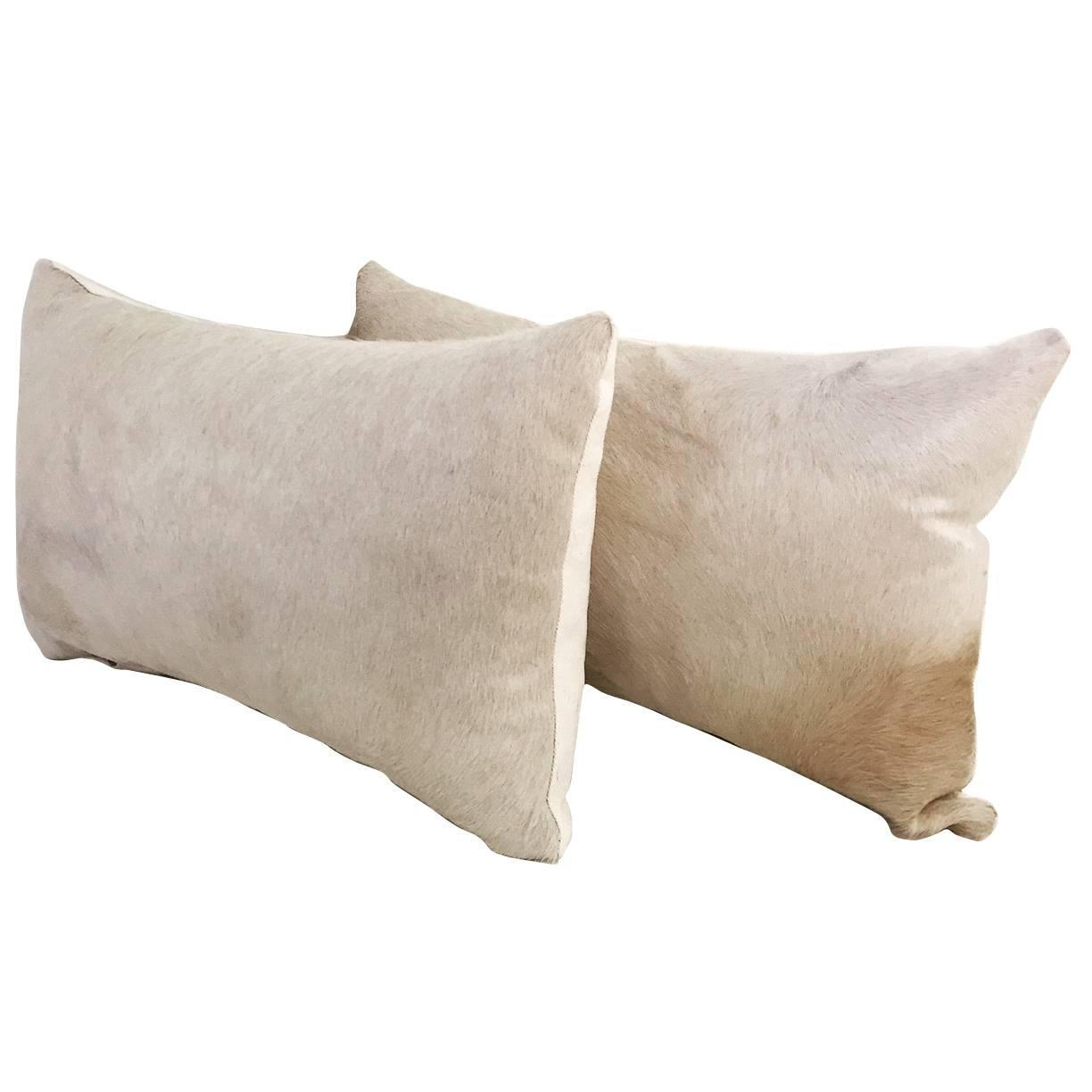 cowhide sofa throws faux leather 2 seater bed with center armrest pair rare ivory pillows at 1stdibs
